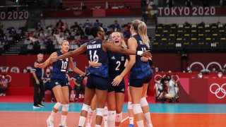 Foluke Akinradewo #16, Jordyn Poulter #2 and Andrea Drews #11 of Team United States celebrate while competing against Team Serbia during the Women's Semifinals on day fourteen of the Tokyo 2020 Olympic Games at Ariake Arena on August 06, 2021 in Tokyo, Japan.