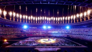 Fireworks erupt above the stadium during the Closing Ceremony of the Tokyo 2020 Olympic Games