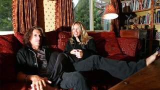 Joe Perry poses for photos with his wife, Billie Paulette