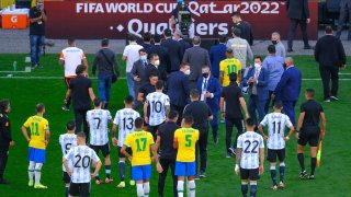 Players leave the area after the World Cup Qualifier game between Brazil and Argentina was suspended