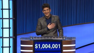 """This photo provided by Jeopardy Productions Inc. shows """"Jeopardy!"""" contestant Matt Amodio after his total win amount was announced, Sept. 24, 2021. Amodio, a fifth-year computer science Ph.D student at Yale University, won $48,800 for his 28th victory, bringing his total winnings to $1,004,001."""
