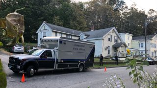 Connecticut State Police van in front of a gray house.