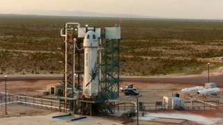 This photo provided by Blue Origin, Blue Origin's New Shepard rocket sits on a spaceport launch pad near Van Horn, Texas, Tuesday, July 20, 2021.