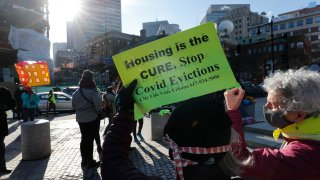tenants rights advocates demonstrate outside the Edward W. Brooke Courthouse in Boston