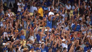 Los Angeles Dodgers fans in stands doing the wave during game vs Los Angeles Angels