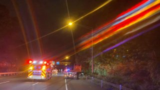 emergency vehicles on side of highway