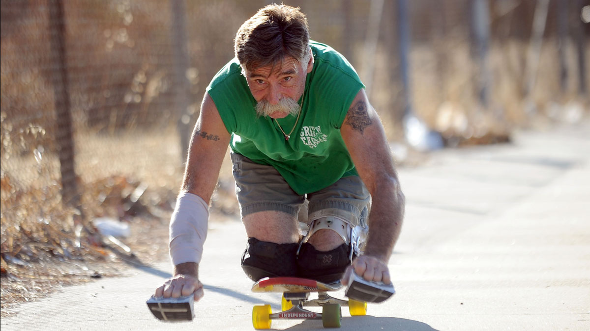 Jesse Swalley of Sylmar, became paralyzed in one of his legs after he was stabbed in 1991.  He now rides long distances on his skateboard while kneeling.