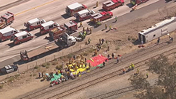 Up to 40 people were injured when a tour bus overturned on the Foothill (210) Freeway in Irwindale on Thursday, Aug. 22, 2013.