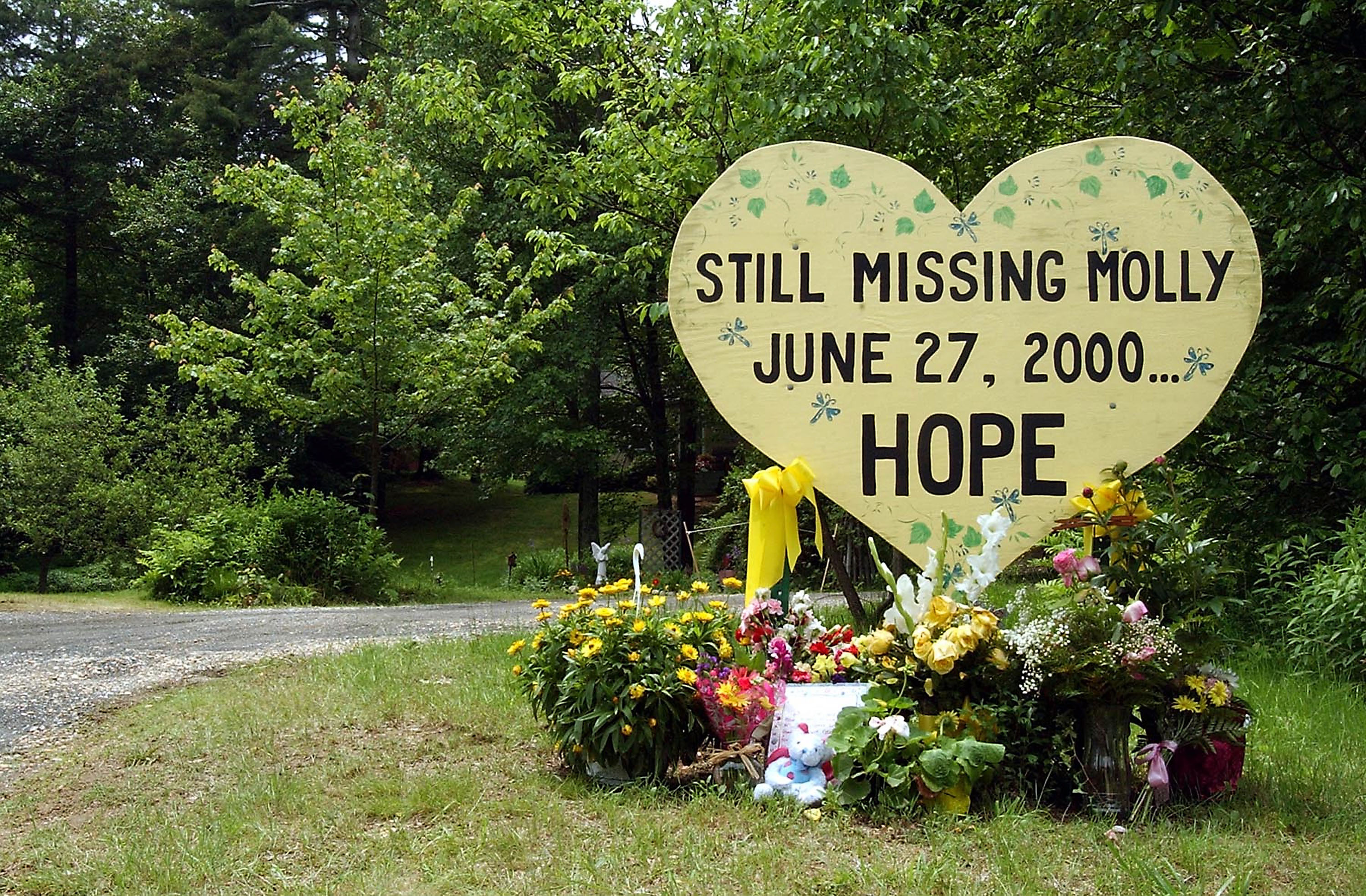 WARREN, MA - JUNE 12: A message adorns the yard of the family of missing lifeguard Molly Bish June 12, 2003 in Warren, Massachusetts. The remains of Bish, who disappeared in 2000 from her post at the rural pond where she worked, were positively identified. (Photo by Jessica Rinaldi/Getty Images)