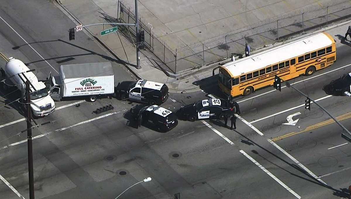A stolen catering truck being pursued by police struck a bus carrying dozens of children and a propane gas tanker in San Bernardino on Monday, Feb. 29, 2016. Two people were taken into custody.