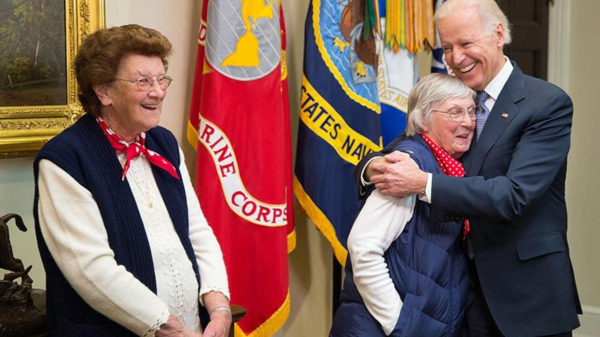 Mariann Wynn (left ) looks on as Phyllis Gould gets a hug from Vice President Joe Biden. March 31, 2014