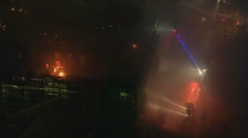 Firefighters late Tuesday continue to work on containing a massive, multiple-alarm fire that erupted near AT&T Park in San Francisco.
