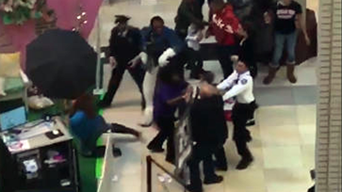 Security guards break up a fight between an Easter Bunny and a father at a mall in Jersey City Sunday.