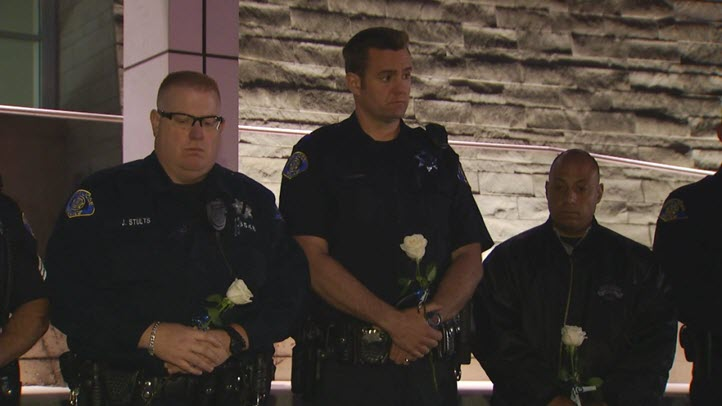 Officers attend a vigil Friday night for slain SJ Officer Michael Johnson.