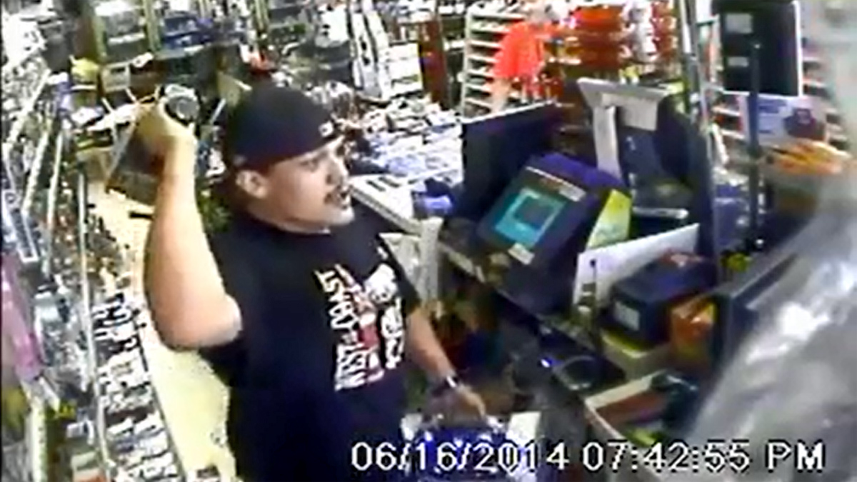 Suspect seen waving bottle of Jack Daniels at liquor store clerk on Bascom Avenue near San Jose. June 16, 2014