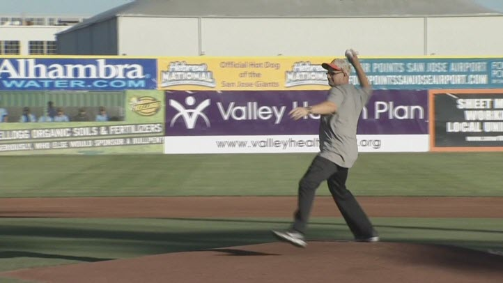 Tim Watson, who helped rescue a kidnapped child, throws out the first pitch at the San Jose Giants game on Friday. (June 19, 2015)