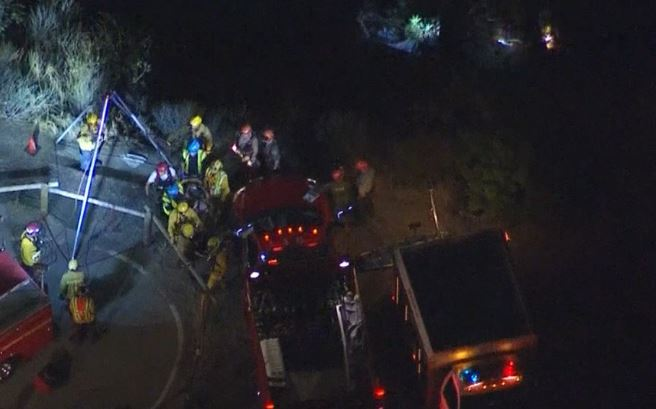 Two children died and three other people were injured when the car they were in careened into a steep ravine in Azusa July 4, 2015.
