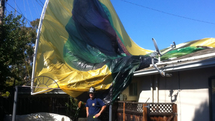 A huge insurance sign being towed by a plane came loose and fell directly onto a Fremont home.