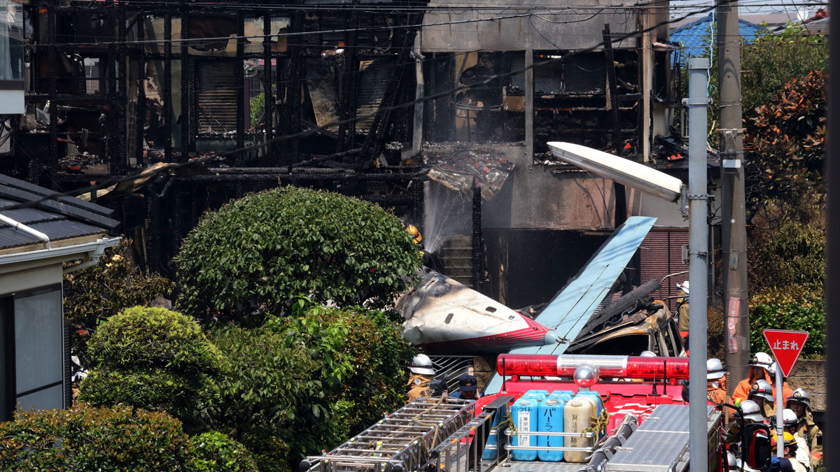 A light plane crashed into a residential area in Tokyo early on July 26, setting fire to several houses and reportedly killing three people, according to officials and local media.