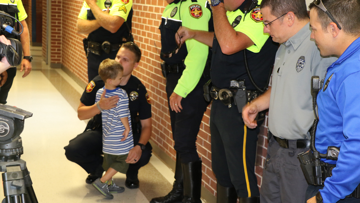 Nearly two dozen Amarillo police officers escorted the 4-year-old son of a fallen officer to school on his first day.