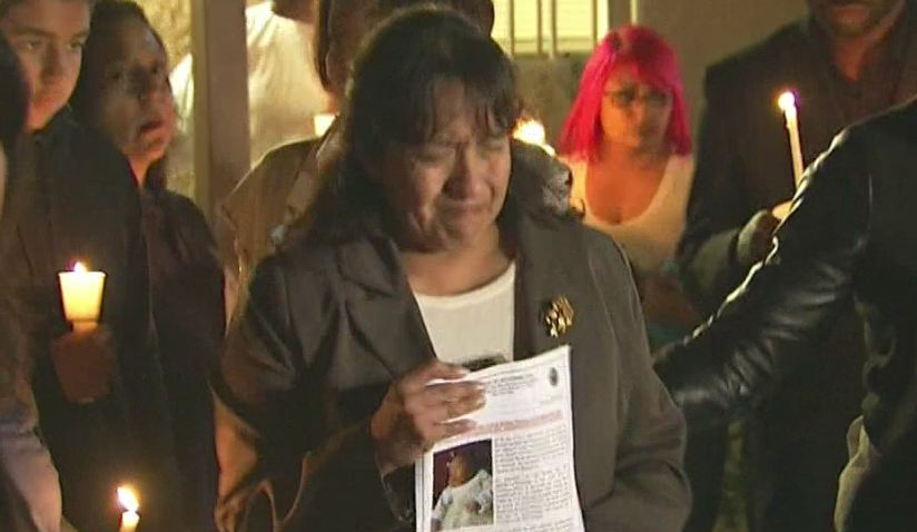 The grandmother of a murdered infant found dead in a dumpster begged for witnesses to come forward at a vigil held at the family home in Long Beach Friday, Jan. 9, 2015
