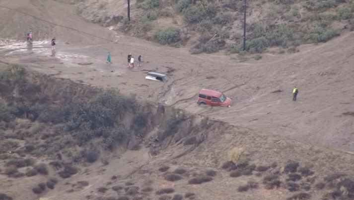 Cars are trapped in mud off Lake Hughes Road in Castaic during flash flooding on Thursday, Oct. 15, 2015.