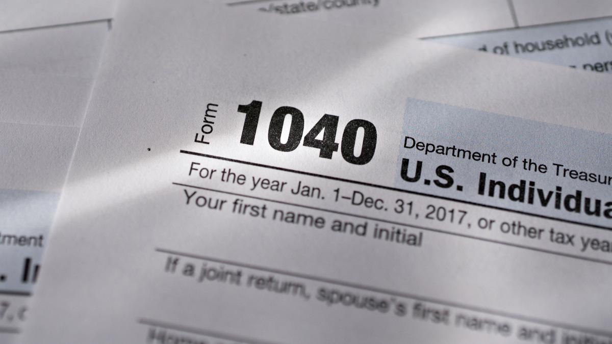 This March 19, 2018, file photo, shows the U.S. Department of the Treasury Internal Revenue Service (IRS) 1040 Individual Income Tax forms for the 2017 tax year arranged for a photograph in Tiskilwa, Illinois, U.S.