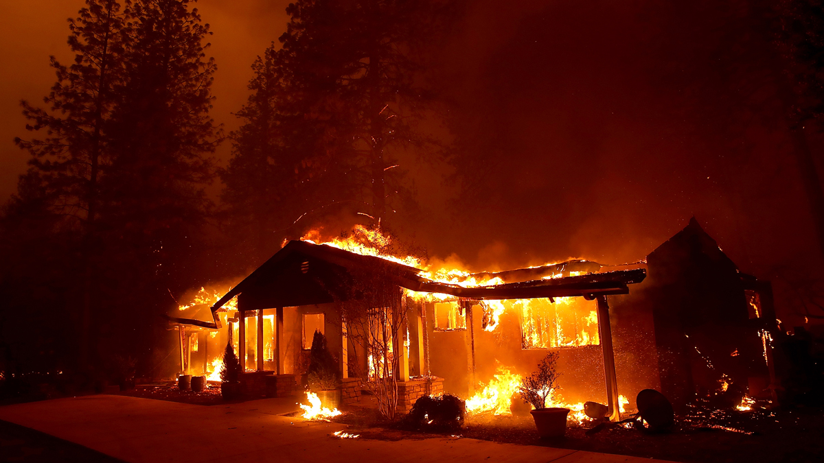 This Nov. 8, 2018, file photo shows a home burn as the so-called Camp Fire moved through the area of Paradise, California.