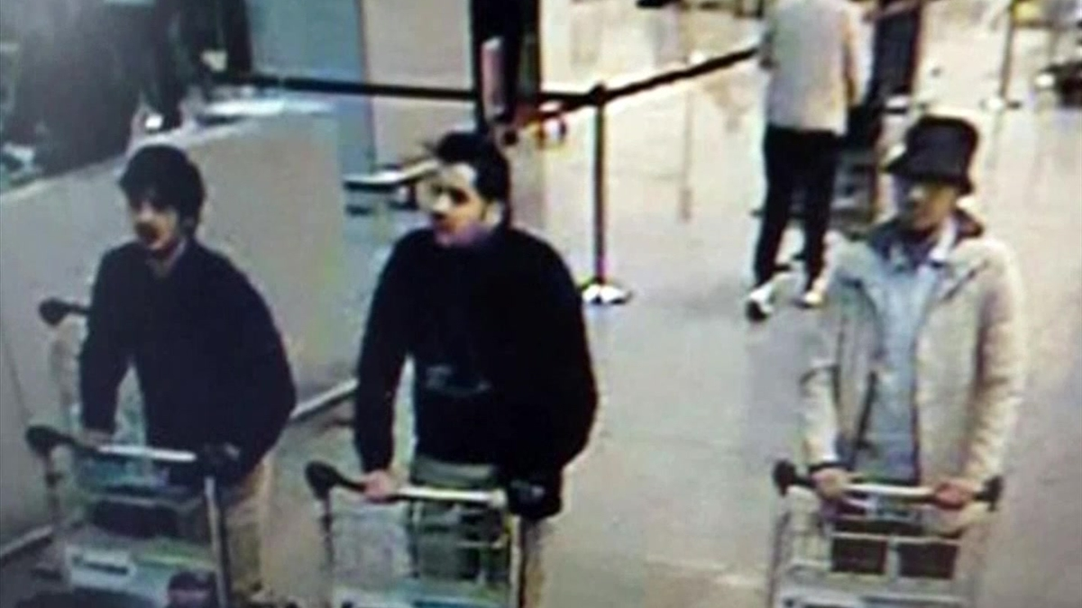Najim Laachraoui (left) is seen in footage from a security camera at Brussels airport on Tuesday.