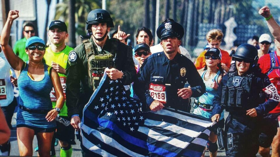LAPD officers Joe Cirrito, third from left, and Kristina Tudor, right, run in the 2015 Los Angeles Marathon.