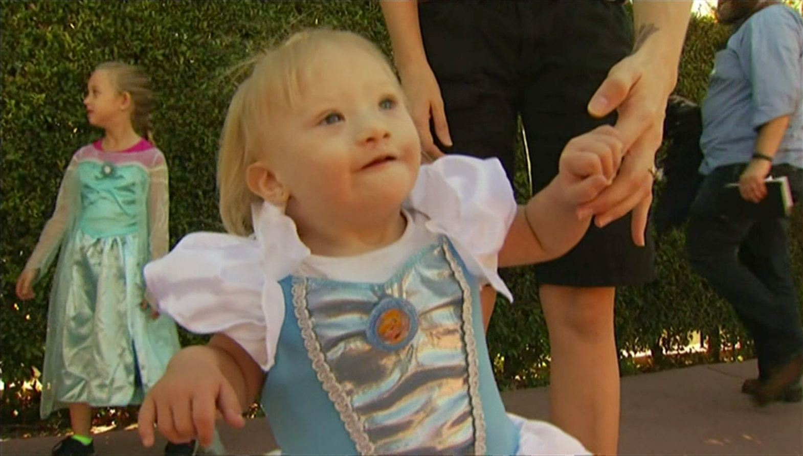 Delaney, a 15-month old girl who has Down syndrome, inspired a petition asking Disney to represent children with disabilities in its animated films. The family presented it at Disney headquarters Wednesday, Nov. 26, 2014.