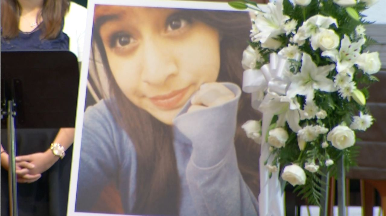 Funerals were held Saturday, Nov. 8, 2014, for the three 13-year-old girls killed in a Halloween night hit-and-run collision. This picture of Andrea Gonzalez stood in front of her casket at her funeral in the Holy Family Cathedral in Orange.