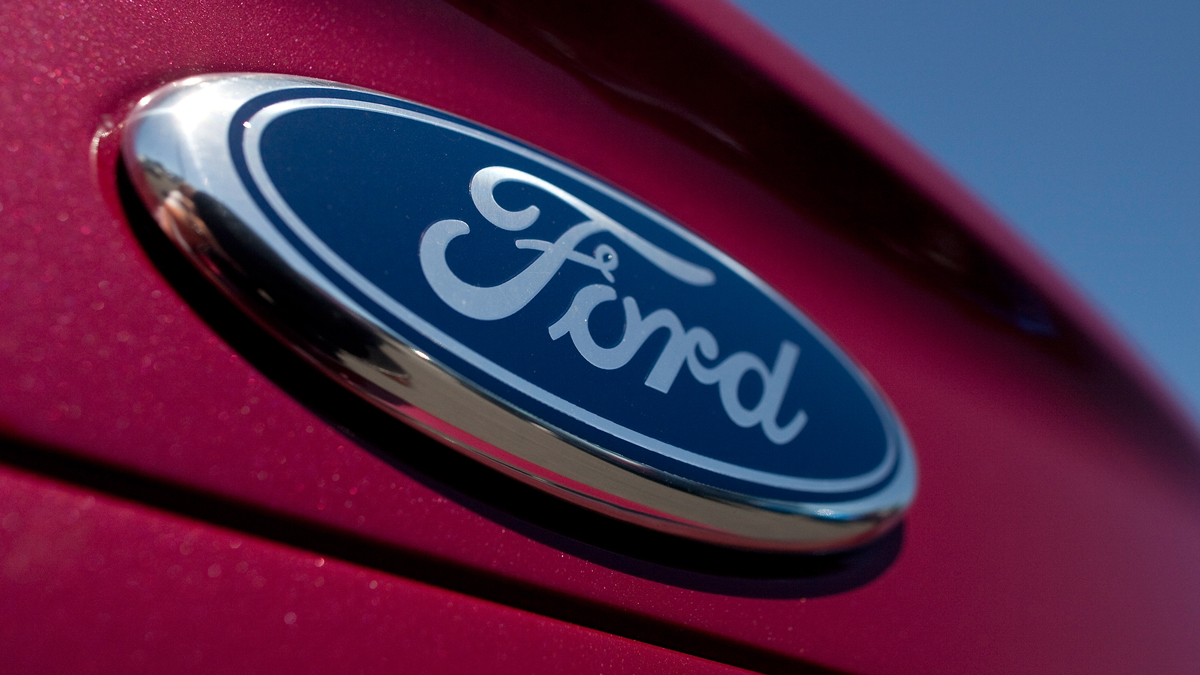 This April 26, 2011, file photo shows the Ford Motor Co. logo on a Ford Fusion at the Serramonte Ford dealership in Colma, California.