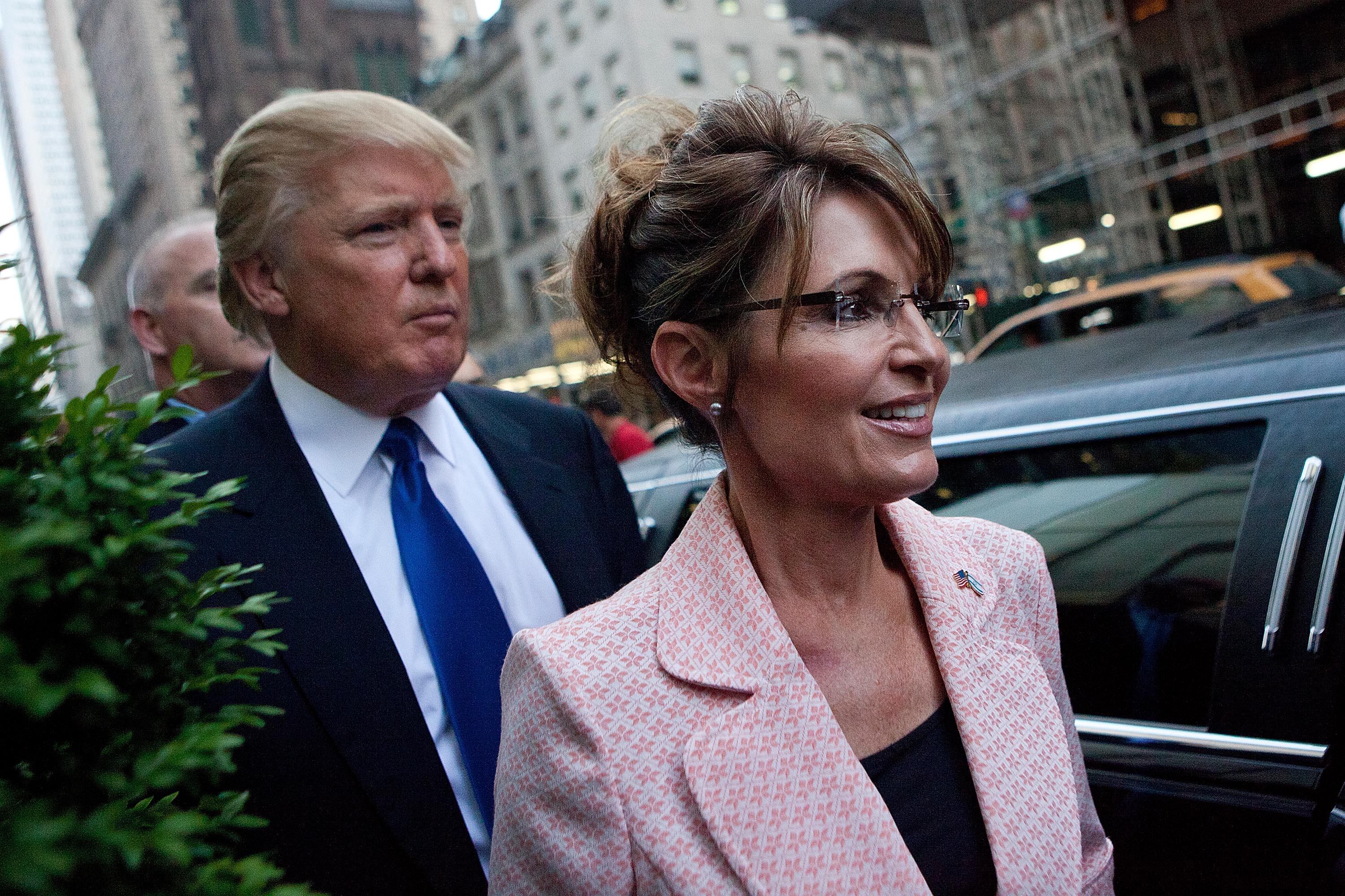 Former U.S. Vice presidential candidate and Alaska Governor Sarah Palin (R), and Donald Trump walk towards a limo after leaving Trump Tower, at 56th Street and 5th Avenue, on May 31, 2011 in New York City.