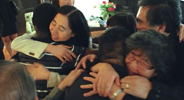 Grace and Matthew Huang, a US couple who were sentenced to three years in jail in Qatar in April 2014 for allegedly causing the death of their adopted daughter Gloria, embrace with family and friends on their arrival in Los Angeles on Dec. 4, 2014.