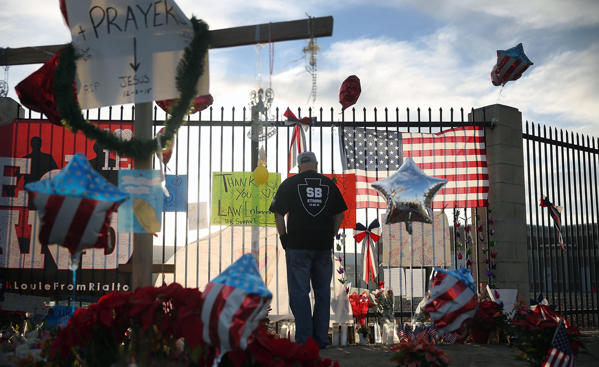 David Santos visits a memorial for those killed and injured near the Inland Regional Center on Dec. 7, 2015 in San Bernardino, California.