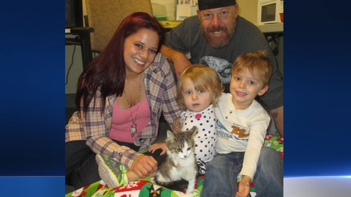 The Tipton family adopted 3-month-old Holly, who had to have a front leg amputated after an injury, for their 2-year-old daughter Scarlette, who had to have an arm amputated due to cancer, on Dec. 30, 2015.