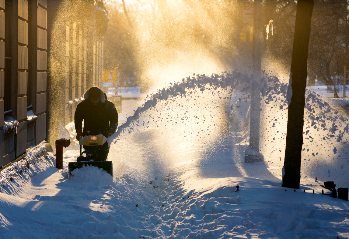 Some building superintendents on Manhattan's Upper West Side attacked the problem with snow blowers. (AP Photo/Craig Ruttle)