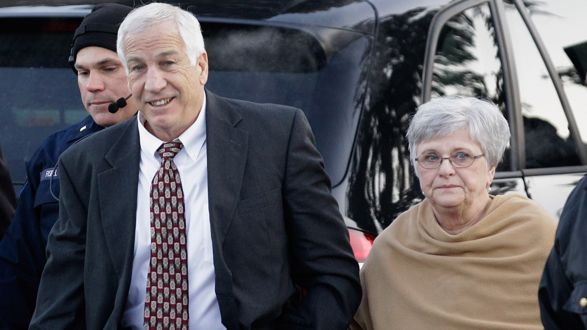 Former Penn State assistant football coach, Jerry Sandusky and his wife Dottie arrive at the Centre County Courthouse on December 13, 2011 in Bellefonte, Pennsylvania. Dottie Sandusky spoke to