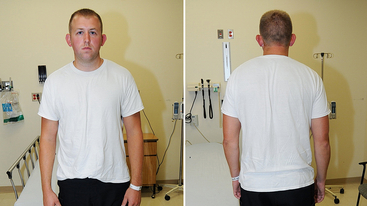 Ferguson police officer Darren Wilson appears after being involved in the shooting death of 18-year-old Michael Brown on Aug. 9.