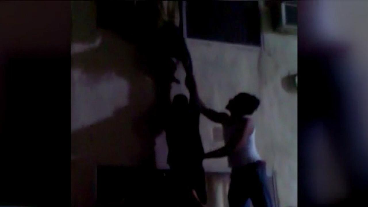 Motel guests escape a fire through a second-story window on Thursday, Dec. 25, 2014.