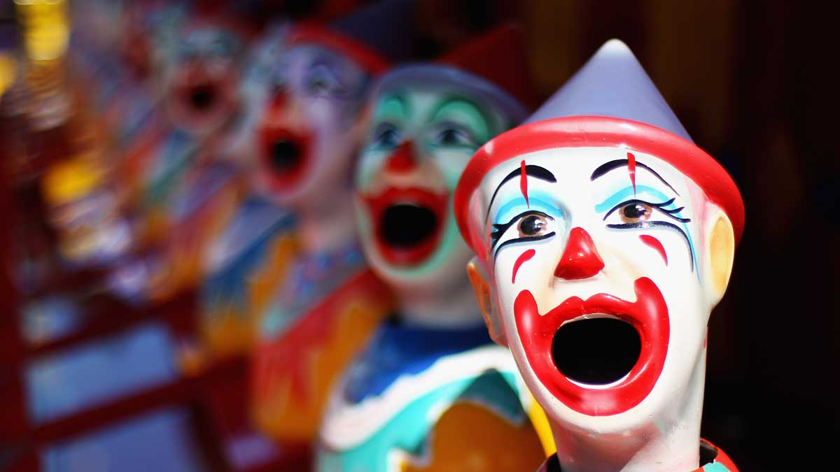 In this April 5, 2012, file photo, laughing clowns are seen in the carnival area during the 2012 Sydney Royal Easter Show at the Sydney, Australia, Showground.