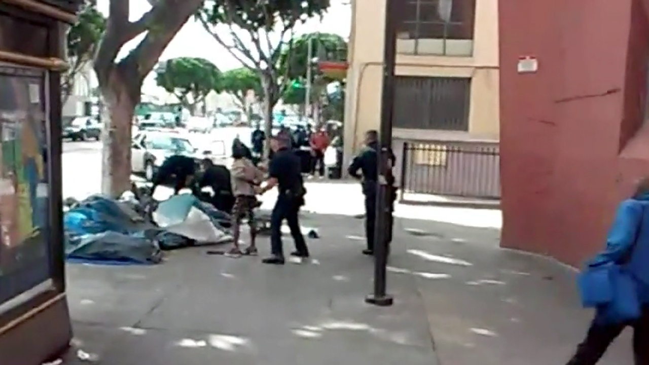This still from cellphone video shows the moments when a person was killed in an officer-involved shooting in downtown Los Angeles on Sunday, March 1, 2015.