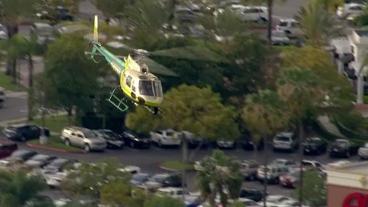 A Los Angeles County sheriff's helicopter assists in the search for an escaped inmate in the Lomita area on Sunday, March 1, 2015.