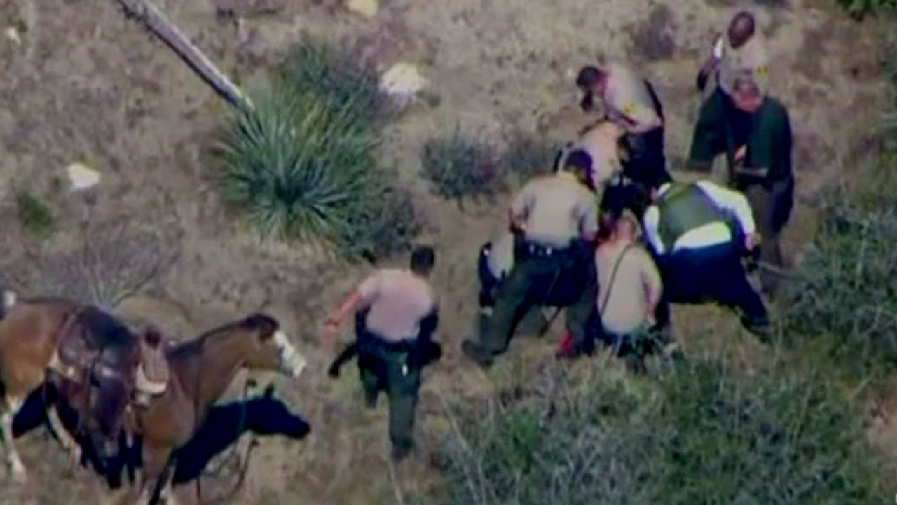San Bernardino County sheriff's deputies beat a man at the end of a pursuit in the high desert on Thursday, April 9, 2015.