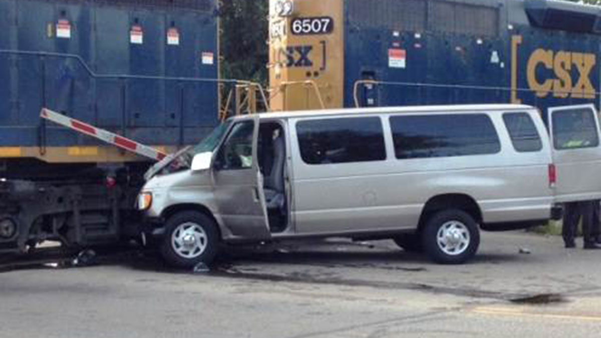 A van drove through a crossing gate and into a train on Tuesday, July 28, 2015, in Middletown, Ohio, police said.