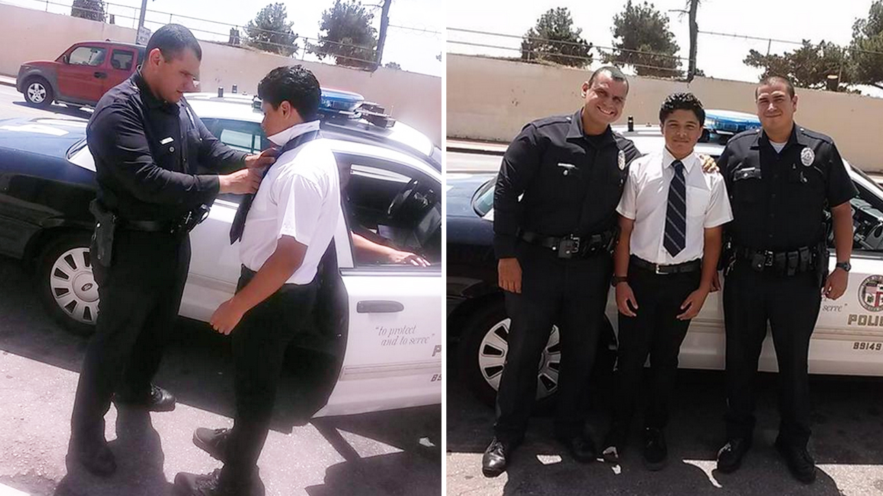 An LAPD officer pulled over to help a boy tie his necktie on his way to school on Thursday, August 13, 2015.