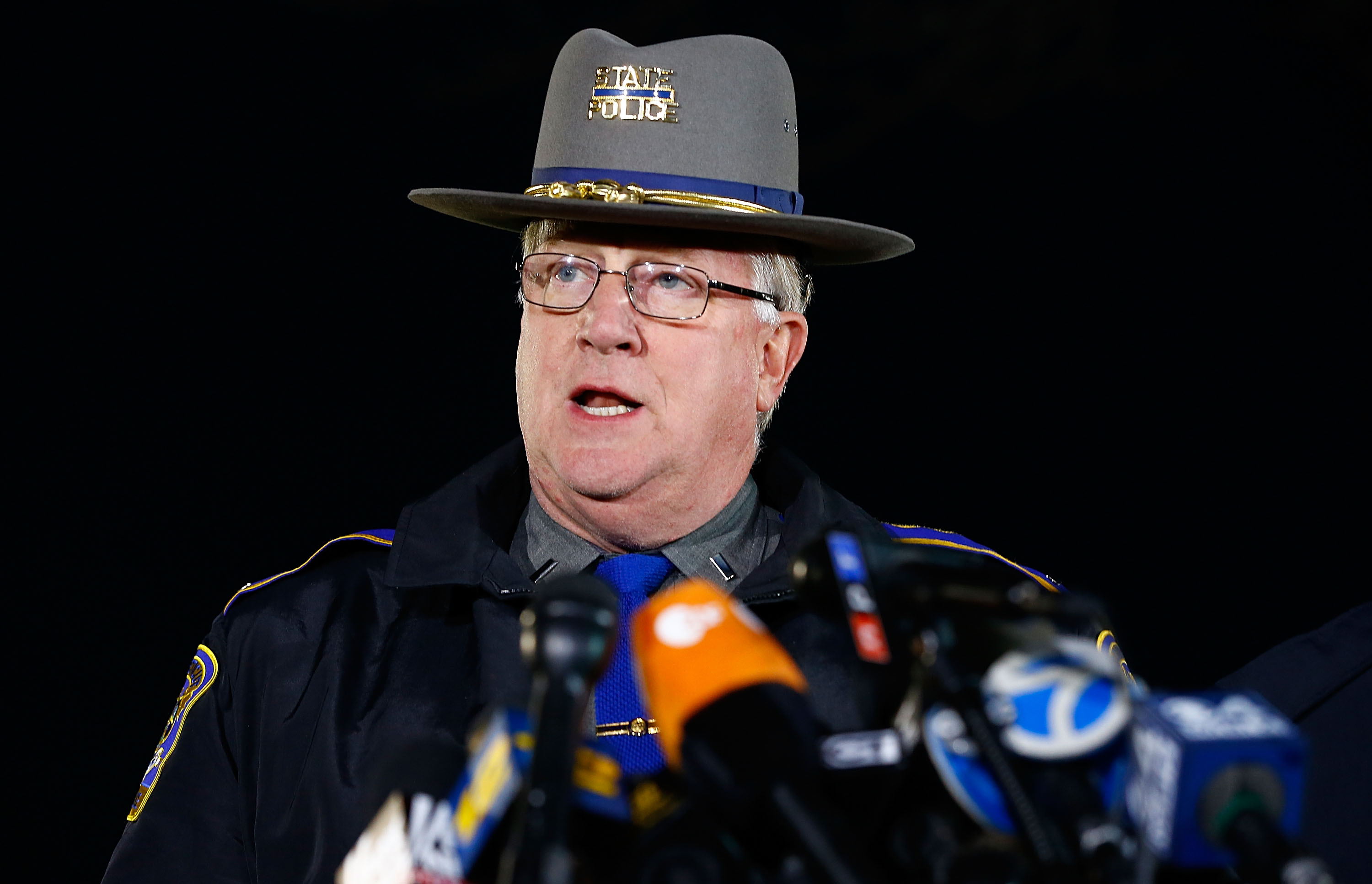 NEWTOWN, CT - DECEMBER 14:  State Police spokesman Lt. J. Paul Vance briefs the media about the elementary school shooting during a press conference at Treadwell Memorial Park on December 14, 2012 in Newtown, Connecticut. According to reports, there are 27 dead, including 20 children, after a gunman identified as Adam Lanza, opened fire in at the Sandy Hook Elementary School in Newtown, Connecticut. The shooter, identified as Adam Lanza was also found dead at the scene. (Photo by Jared Wickerham/Getty Images)