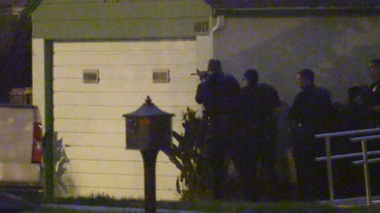 Police descend on a Riverside, California, home with guns drawn after receiving an early morning report of a woman shot dead inside on Tuesday, Feb. 23, 2016. Officers learned that the call was a prank on a teen behind a viral video.