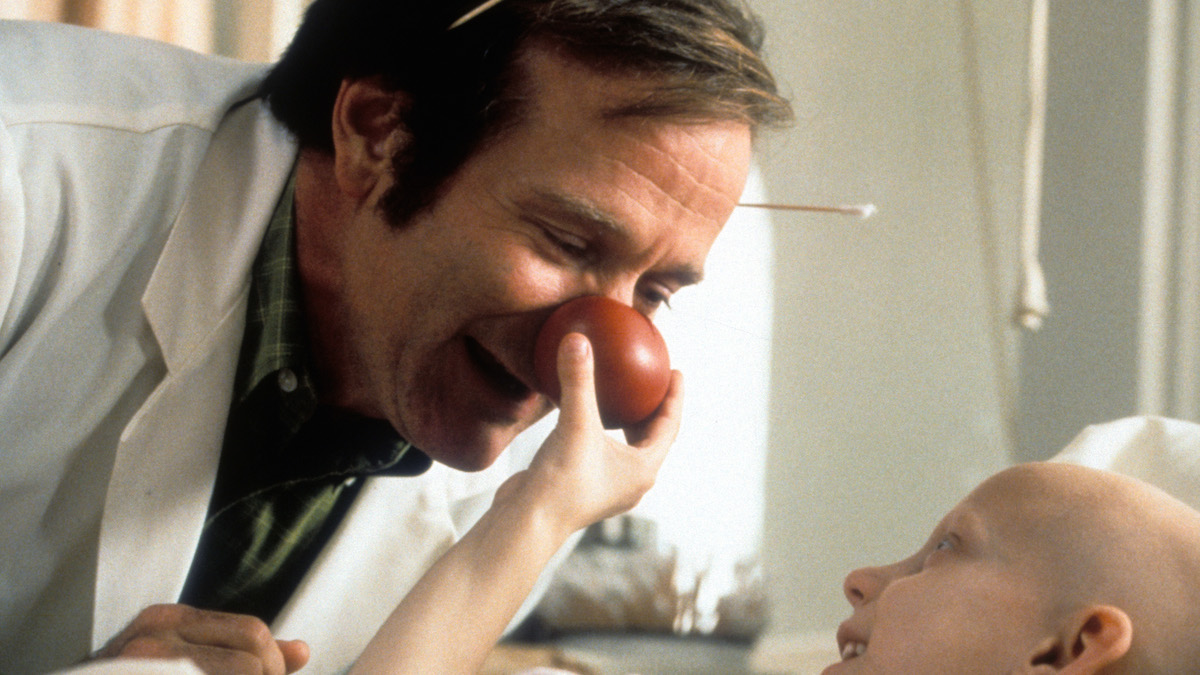 Robin Williams visits a sick child in a scene from the film 'Patch Adams', 1998.